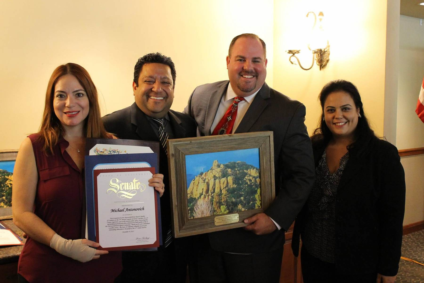 Jerrod-DeGonia-accepting-the-Legends-and-Heroes-award-on-behalf-of-Michael-Antonovich.